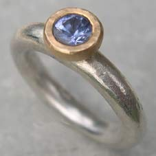 designer silver engagement ring with sapphire