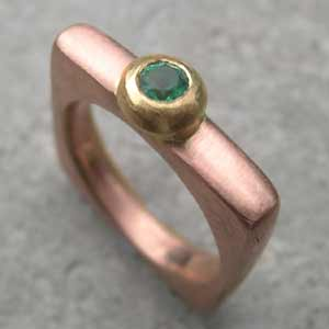 Emerald Engagement Ring  in red gold with a yellow gold setting