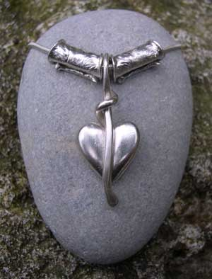 Silver heart pendant with textured silver beads