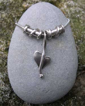 Silver heart pendant with twist beads