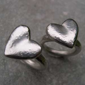 Two large hearts on silver rings