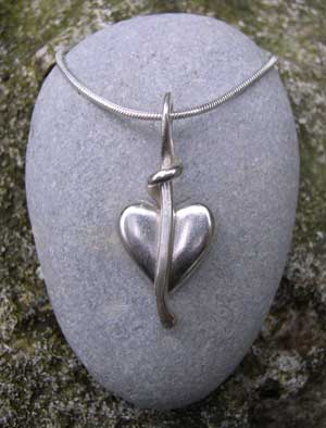 Heart pendant on silver snake chain